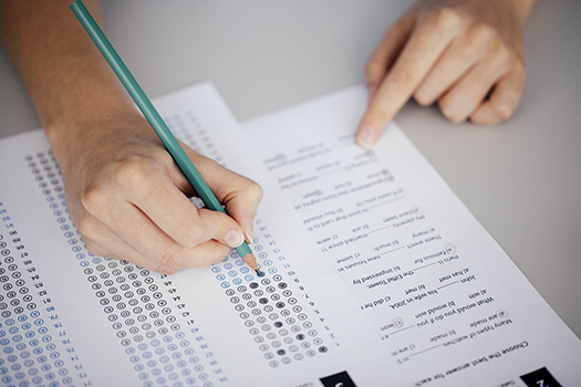 Student bubbling in answers on an Exam